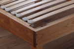Euro bed with built-in flexible slat suspension